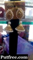 Beautiful  White moti and stone earings at affordable price.
