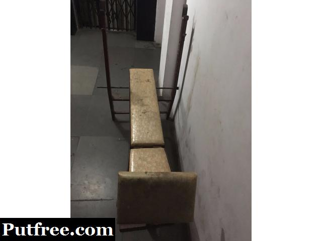 Gym bench with weight and dumbbells
